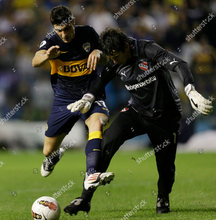 Argentina's Boca Juniors' Nicolas Blandi, left, vies for the ball with Argentina's Independiente's goalkeeper Hilario Navarro during a Copa Sudamericana soccer match in Buenos Aires, Argentina