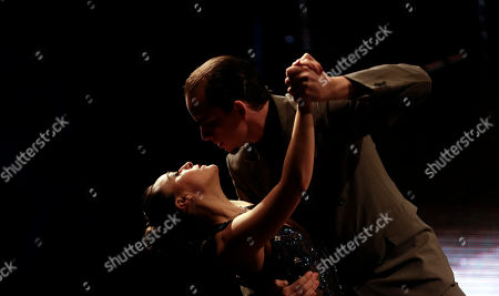 Colombian tango dance couple John Osorio and Diana Lopez compete in a stage category at the Tango Dance World Cup 2012 in Buenos Aires, Argentina, . The two-week long event offers hundreds of free dance lessons, concerts and recitals, as professional dancers compete in the championship and teach many the eight basic steps of the dance in the city where it was born