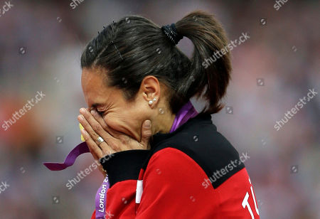 Turkey's Asli Cakir Alptekin poses with her gold medal for the women's 1500-meter during the athletics in the Olympic Stadium at the 2012 Summer Olympics, London. The credibility of the IAAF and sports in Russia will be on the line when a report on extortion and doping cover-ups is published