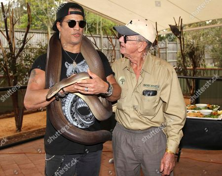 Slash, Bob Irwin American rock band Guns N' Roses lead guitarist Slash, holding Kalamata, a four-meter olive python, poses with 72-year-old Australian wildlife warrior Bob Irwin at the launch of the Bob Irwin Wildlife and Conservation Foundation Inc. in Brisbane, Australia, . The foundation was formed to provide ongoing support to Bob Irwin, the father of the late crocodile hunter Steve Irwin, in his life long commitment to preserving the planet's wildlife