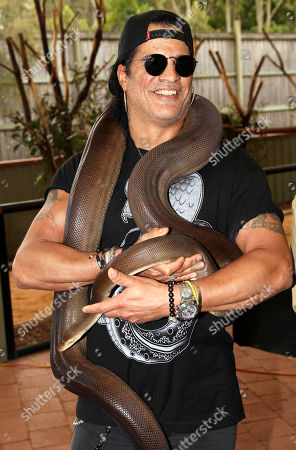 Slash American rock band Guns N' Roses' lead guitarist Slash poses with Kalamata, a four-meter olive python, at the launch of the Bob Irwin Wildlife and Conservation Foundation Inc. in Brisbane, Australia, . The foundation was formed to provide ongoing support to Bob Irwin in his life long commitment to preserving the planet's wildlife