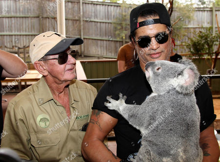 Slash, Bob Irwin American rock band Guns N' Roses lead guitarist Slash, holding a koala named Tinkerbell, poses with 72-year-old Australian wildlife warrior Bob Irwin at the launch of the Bob Irwin Wildlife and Conservation Foundation Inc. in Brisbane, Australia, . The foundation was formed to provide ongoing support to Bob Irwin, the father of the late crocodile hunter Steve Irwin, in his life long commitment to preserving the planet's wildlife