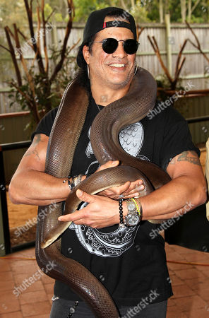Slash American rock band Guns N' Roses' lead guitarist Slash poses with Kalamata, a four-meter olive python, at the launch of the Bob Irwin Wildlife and Conservation Foundation Inc. in Brisbane, Australia, . The foundation was formed to provide ongoing support to Bob Irwin, the father of the late crocodile hunter Steve Irwin, in his life long commitment to preserving the planet's wildlife