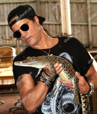Slash American rock band Guns N' Roses' lead guitarist Slash poses with Wickham, a salt water crocodile, at the launch of the Bob Irwin Wildlife and Conservation Foundation Inc. in Brisbane, Australia, . The foundation was formed to provide ongoing support to Bob Irwin in his life long commitment to preserving the planet's wildlife