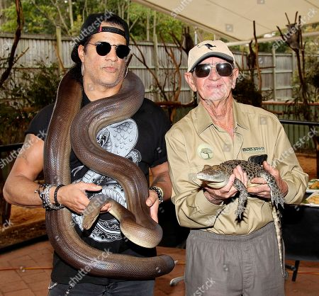 Slash, Bob Irwin American rock band Guns N' Roses lead guitarist Slash, left, poses with 72-year-old Australian wildlife warrior Bob Irwin, holding Kalamata, a four-meter olive python, and Wickham, a saltwater crocodile respectively, at the launch of the Bob Irwin Wildlife and Conservation Foundation Inc. in Brisbane, Australia, . The foundation was formed to provide ongoing support to Bob Irwin in his life long commitment to preserving the planet's wildlife