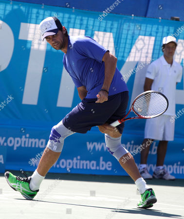 Mark Philippousis Australia's Mark Philippousis returns the ball to Sweden's Thomas Enqvist during the ATP Champions Tour Optima Open tennis in Knokke-Heist, Belgium on