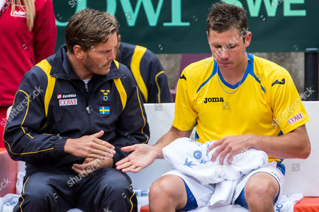 Michael Ryderstedt, Thomas Enqvist Sweden's Michael Ryderstedt, right, talks with team captain Thomas Enqvist during his Davis Cup World Group Play-off round match against Belgium's Steve Darcis at Royal Primerose Tennis Club in Brussels