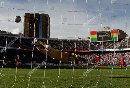 Bolivia's Alejandro Chumacero scores as Peru's goalkeeper Jose Carvallo, front, fails to make a save during a 2014 World Cup qualifying soccer match in La Paz, Bolivia