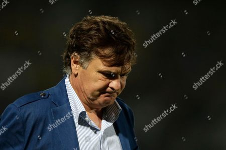 China's coach Jose Antonio Camacho, of Spain, reacts while walking off the field after the 8-0 loss to Brazil in a friendly soccer match in Recife, Brazil