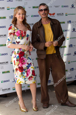 """Kylie Minogue, Leos Carax Australian singer and actress Kylie Minogue, left, stands with French film director Leos Carax as they attend an event promoting their film """"Holy Motors"""" at the Rio Film Festival, in Rio de Janeiro, Brazil, . The film festival runs through Oct. 11"""