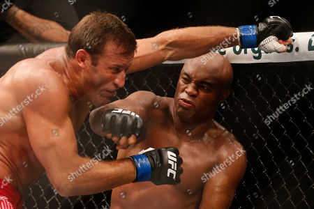 Anderson Silva, Stephan Bonnar Anderson Silva, from Brazil, right, fights Stephan Bonnar, from the United States, during their light heavyweight mixed martial arts bout at UFC 153 in Rio de Janeiro, early . Silva defeated Bonnar