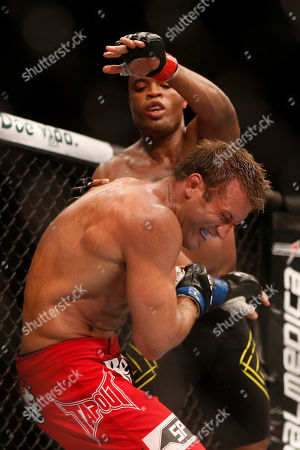 Anderson Silva, Stephan Bonnar Anderson Silva, from Brazil, back, fights Stephan Bonnar, from the U.S., during their light heavyweight mixed martial arts bout at the Ultimate Fighting Championship (UFC) 153 in Rio de Janeiro, Brazil, early . Silva defeated Bonnar