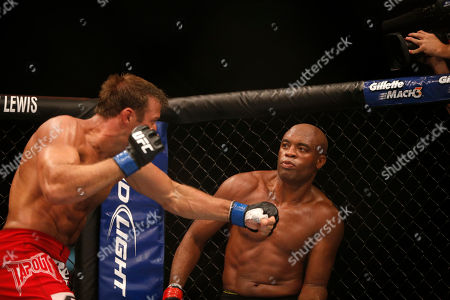 Anderson Silva, Stephan Bonnar Anderson Silva, right, from Brazil, fights Stephan Bonnar, from the United States, during their light heavyweight mixed martial arts bout at the Ultimate Fighting Championship (UFC) 153 in Rio de Janeiro, Brazil, early . Silva defeated Bonnar