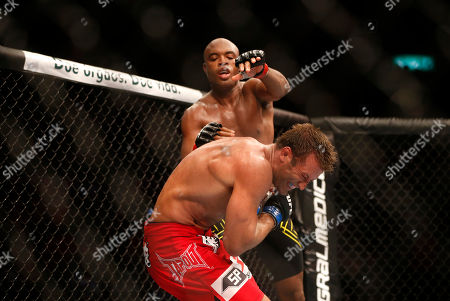 Anderson Silva, Stephan Bonnar Anderson Silva, top, from Brazil, fights Stephan Bonnar, from the United States, during their light heavyweight mixed martial arts bout at the Ultimate Fighting Championship (UFC) 153 in Rio de Janeiro, Brazil, early . Silva defeated Bonnar