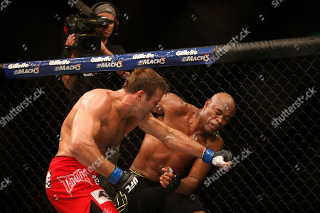 Anderson Silva, Stephan Bonnar Anderson Silva, right, from Brazil, is hit by Stephan Bonnar, from the United States, during their light heavyweight mixed martial arts bout at the Ultimate Fighting Championship (UFC) 153 in Rio de Janeiro, Brazil, early . Silva defeated Bonnar