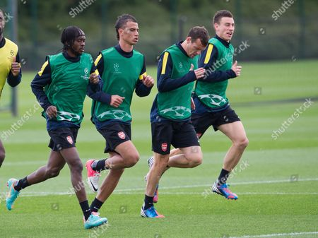 Gervinho, Marouane Chamakh, Sebastien Squillaci and Laurent Koscielny Arsenal's Gervinho, left, Marouane Chamakh, second left, Sebastien Squillaci and Laurent Koscielny, right, warm up during their training session, London Colney, England, . Arsenal will play Greek side Olympiakos in a Champions League group B match in London, Wednesday