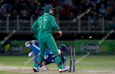 England's Craig Kieswetter, bottom, survives a stumping attempt by South Africa's wicketkeeper AB de Villiers during their Twenty20 International cricket match at Edgbaston cricket ground, Birmingham, England