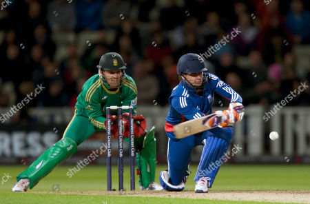 England's Craig Kieswetter plays a shot off the bowling of South Africa's Robin Peterson during their Twenty20 International cricket match at Edgbaston cricket ground, Birmingham, England