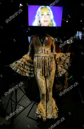A costume designed by Ann Roth and used in the 2008 film Mamma Mia for the character Donna played by Meryl Streep is seen on display at the Hollywood Costume exhibition at the Victoria and Albert museum in London, . Streep is seen in the video display above the costume. The show at the Victoria and Albert Museum showcases more than one hundred movie costumes from a century of film-making. The exhibition opens to the public on Oct. 20, 2012 and run till 27 Jan. 2013