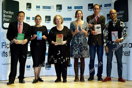 Authors, from left to right, Tan Twan Eng, Deborah Levy, Hilary Mantel, Alison Moore, Will Self and Jeet Thayil, shortlisted for the Man Booker Prize, hold copies of their books during a photo call at the Royal Festival Hall, in London, . The 50,000 British pounds (80,000 US dollars approx.) prize will be announced Tuesday, Oct. 16, 2012