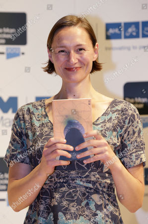 Alison Moore Author Alison Moore, shortlisted for the Man Booker Prize, holds a copy of her book 'The Lighthouse' during a photo call at the Royal Festival Hall, in London, . The 50,000 British pounds (US 80,000 dlrs) prize will be announced Tuesday, Oct. 16