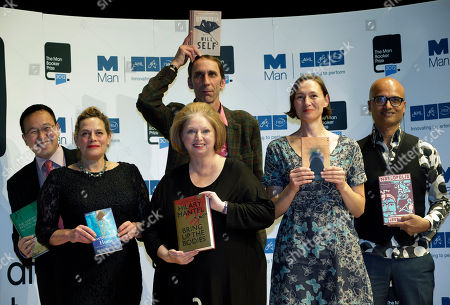 Authors, from left to right, Malaysian Tan Twan Eng, Deborah Levy, Hilary Mantel, Will Self, holding his book, top, Alison Moore and Jeet Thayil, from India, shortlisted for the Man Booker Prize, hold copies of their books during a photo call at the Royal Festival Hall, in London, . The 50,000 British pounds (80,000 US dollars approx.) prize will be announced Tuesday, Oct. 16, 2012