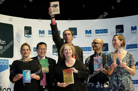 Authors, from left to right, Tan Twan Eng, Deborah Levy, Hilary Mantel, Will Self, holding his book, top, Alison Moore and Jeet Thayil, shortlisted for the Man Booker Prize, hold copies of their books during a photo call at the Royal Festival Hall, in London, . The 50,000 British pounds (80,000 US dollars approx.) prize will be announced Tuesday, Oct. 16, 2012