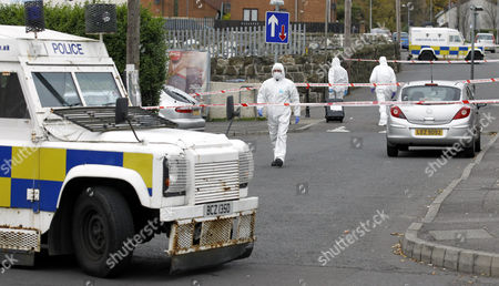 Stock Photo of Northern Ireland forensic officers work at the scene of a shooting in north Belfast, Northern Ireland, . Irish Republican dissident gunman fired from a hijacked car which was later found burned out, in the fatal shooting of 36-year-old identified as Danny McKay in Co Antrim, north Belfast late Thursday, an incident which may have been linked to a fall-out over drugs, according to unidentified local people
