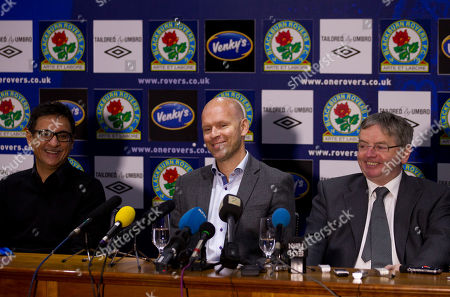Blackburn's new manager Henning Berg, centre, smiles during a press conference as he sits alongside the club's global advisor Shebby Singh, left, and managing director Derek Shaw during a press conference at Ewood Park Stadium, Blackburn, England, . Berg who won the Premier League title as a player with Blackburn Rovers in 1995 succeeds Steve Kean who resigned to end a troubled spell as manager