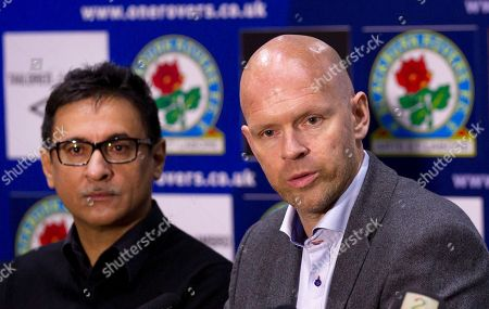 Blackburn's new manager Henning Berg, right, answers questions as he sits alongside the club's global advisor Shebby Singh during a press conference at Ewood Park Stadium, Blackburn, England, . Berg who won the Premier League title as a player with Blackburn Rovers in 1995 succeeds Steve Kean who resigned to end a troubled spell as manager