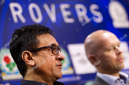 Blackburn's global advisor Shebby Singh, left, answers questions as he sits alongside the club's new manager Henning Berg during a press conference at Ewood Park Stadium, Blackburn, England, . Berg who won the Premier League title as a player with Blackburn Rovers in 1995 succeeds Steve Kean who resigned to end a troubled spell as manager