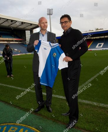 Blackburn's new manager Henning Berg, left, poses for pictures alongside the club's global advisor Shebby Singh at Ewood Park Stadium, Blackburn, England, . Berg who won the Premier League title as a player with Blackburn Rovers in 1995 succeeds Steve Kean who resigned to end a troubled spell as manager