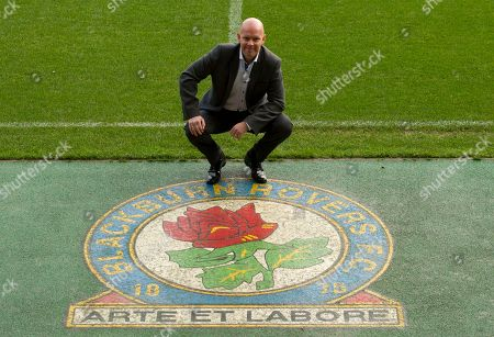 Blackburn's new manager Henning Berg poses for pictures at Ewood Park Stadium, Blackburn, England, . Berg who won the Premier League title as a player with Blackburn Rovers in 1995 succeeds Steve Kean who resigned to end a troubled spell as manager