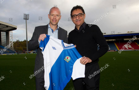 Stock Picture of Blackburn's new manager Henning Berg, left, poses for pictures alongside the club's global advisor Shebby Singh at Ewood Park Stadium, Blackburn, England, . Berg who won the Premier League title as a player with Blackburn Rovers in 1995 succeeds Steve Kean who resigned to end a troubled spell as manager