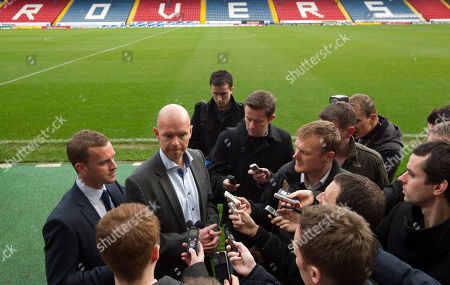Stock Image of Blackburn's new manager Henning Berg, centre left, answers questions at Ewood Park Stadium, Blackburn, England, . Berg who won the Premier League title as a player with Blackburn Rovers in 1995 succeeds Steve Kean who resigned to end a troubled spell as manager