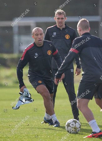Former player Mikael Silvestre, left, trains with Manchester United's Alexander Buttner, right, and Darren Fletcher as the team train at Carrington training ground, in Manchester, . Manchester United will play CFR Cluj-Napoca in a Champion's League group H soccer match on Tuesday