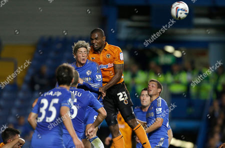 Chelsea's Fernando Torres, top left, goes for the ball with Wolverhampton Wanderers Ronald Zubar during their English League Cup soccer match at Chelsea's Stamford Bridge stadium in London