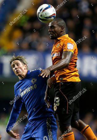 Chelsea's Fernando Torres, left, challenges Wolverhampton Wanderers Ronald Zubar during their English League Cup soccer match at Chelsea's Stamford Bridge stadium in London
