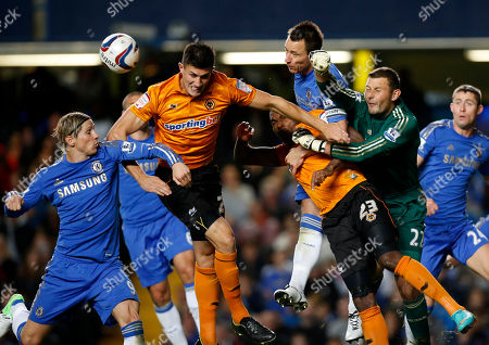 Chelsea's captain John Terry, third right, heads the ball away from Wolverhampton Wanderers' Ronald Zubar, fourth right, as goalkeeper Ross Turnbull, second right, attempts to punch the ball away during the English League Cup soccer match between Chelsea and Wolverhampton Wanderers at Stamford Bridge stadium in London