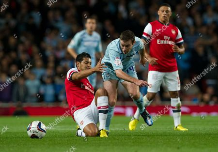 Andre Santos, Stephen Elliott Arsenal's Andre Santos, left, tackles Coventry City's Stephen Elliott during their English League Cup soccer match at the Emirates stadium, London