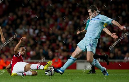 Francis Coquelin, Stephen Elliott Arsenal's Francis Coquelin, left, tackles Coventry City's Stephen Elliott during their English League Cup soccer match at the Emirates stadium, London
