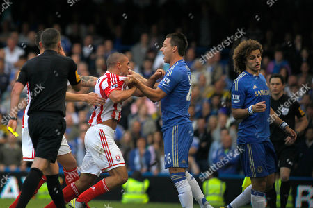 John Terry, David Luiz, Jonathan Walters Chelsea's John Terry, second right, holds back Stoke City's Jonathan Walters, second left, as he reacts to a foul by Chelsea's David Luiz, right, during their English Premier League soccer match at Stamford Bridge, London