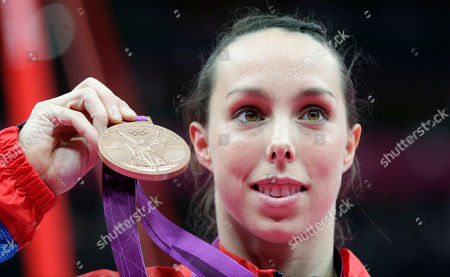 Britain's gymnast Elizabeth Tweddle as she displays the bronze medal for her performance on the uneven bars during the artistic gymnastics women's apparatus finals at the 2012 Summer Olympics in London. Olympic bronze medalist gymnast Beth Tweddle is recovering in an Austrian hospital on Monday Feb. 8, 2016, after undergoing neck surgery following a fall while training for a winter sports reality television show