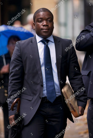 Former city trader Kweku Adoboli, accused of fraud and false accounting while employed at Swiss banking giant UBS, allegedly involving losses of some 1.5 billion pounds ($2.4 billion/1.8 billion euro) on unauthorized deals, as he arrives at Southwark Crown Court in London for his ongoing trial