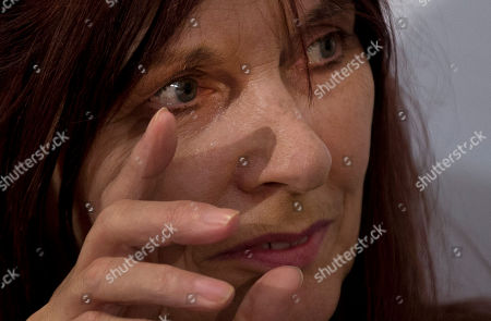 "Janis Sharp, the mother of British computer hacker Gary McKinnon wipes a tear from her eye during a news conference in London, . McKinnon's decade-long struggle to avoid trial in the U.S. over alleged breaches of military and NASA networks ended in success Tuesday, as the U.K. government ruled he was unfit to face charges there. Britain's Home Secretary Theresa May said she had blocked the U.S. request to extradite Gary McKinnon after medical experts concluded he was seriously depressed and that there was ""a high risk of him ending his life"