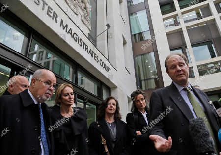 Financial backers of Wikileaks founder Julian Assange listen to Vaughan Smith, right, founder of the Frontline Club, talks to members of the media outside Westminster Magistrates Court, in central London, as supporters of WikiLeaks founder Julian Assange are waiting to find out if they will lose the bail surety money, because Assange has sought political asylum in Ecuador's Embassy in London. Assange, 41, has been holed up in the Ecuadorian embassy in London since June 19 as part of his bid to avoid extradition to Sweden, where he faces questioning over sex-crimes allegations