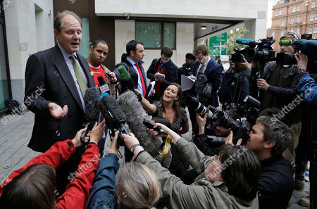 Vaughan Smith, left, founder of the Frontline Club, talks to members of the media outside Westminster Magistrates Court, in central London, as supporters of WikiLeaks founder Julian Assange are waiting to find out if they will lose the bail surety money they posted because Assange has sought political asylum in Ecuador's Embassy in London. Assange, 41, has been holed up in the Ecuadorian embassy in London since June 19 as part of his bid to avoid extradition to Sweden, where he faces questioning over sex-crimes allegations