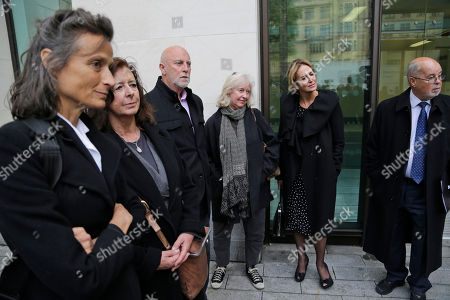 Unidentified financial backers of Wikileaks founder Julian Assange listen to Vaughan Smith, founder of the Frontline Club, not pictured, as they face members of the media outside Westminster Magistrates Court, in central London, as supporters of WikiLeaks founder Julian Assange are waiting to find out if they will lose the bail surety money, because Assange has sought political asylum in Ecuador's Embassy in London. Assange, 41, has been holed up in the Ecuadorian embassy in London since June 19 as part of his bid to avoid extradition to Sweden, where he faces questioning over sex-crimes allegations