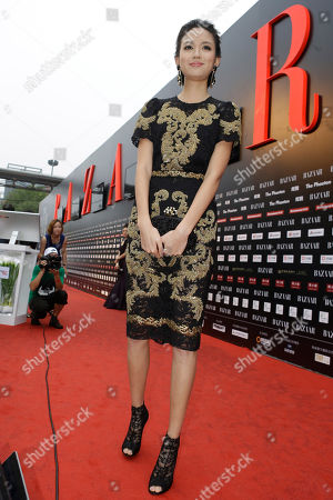 Zhang Zilin Miss World 2007, Zhang Zilin wears a dress from a new collection of Dolce&Gabbana during a charity event held in Beijing, China