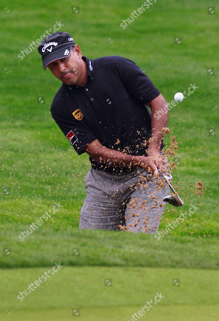 Jeev Milkha Singh Jeev Milkha Singh of India hits out of a bunker on the 18th green during the first round of the Masters golf tournament in Shanghai, China on